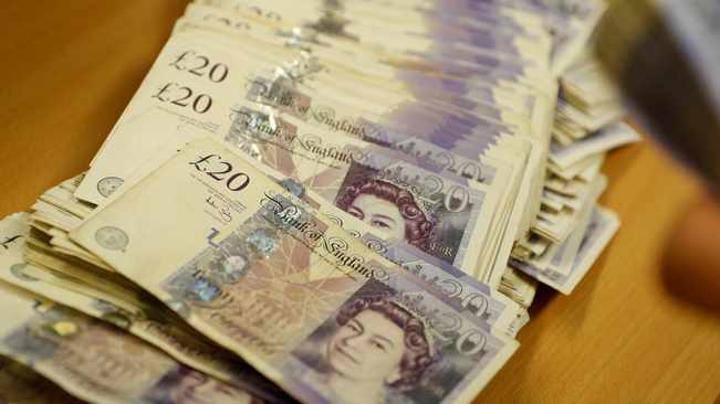 Dollar recovery pushes sterling below $1.35